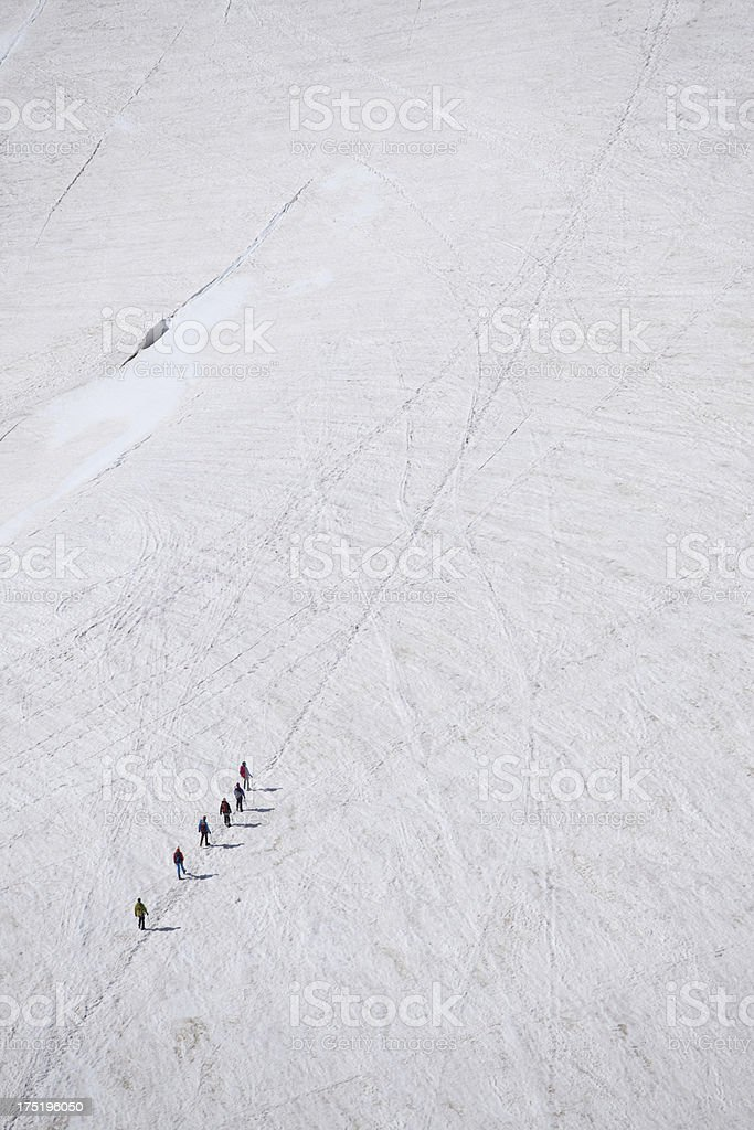 people hiking on a glacier royalty-free stock photo