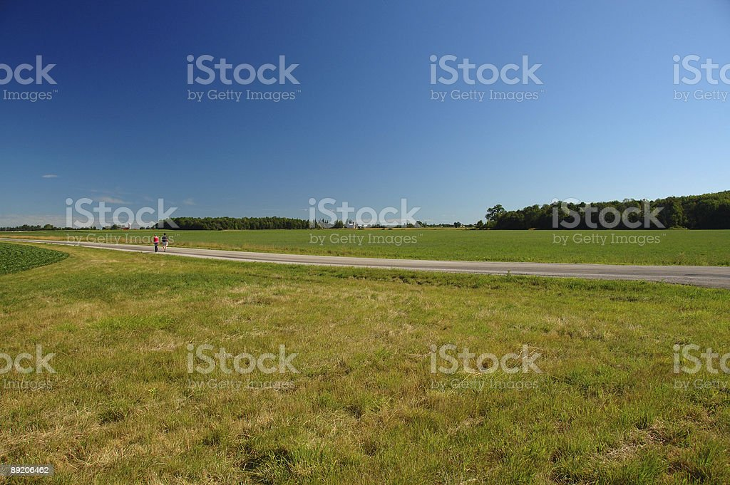 People hiking on an Ontario countryside road near London stock photo