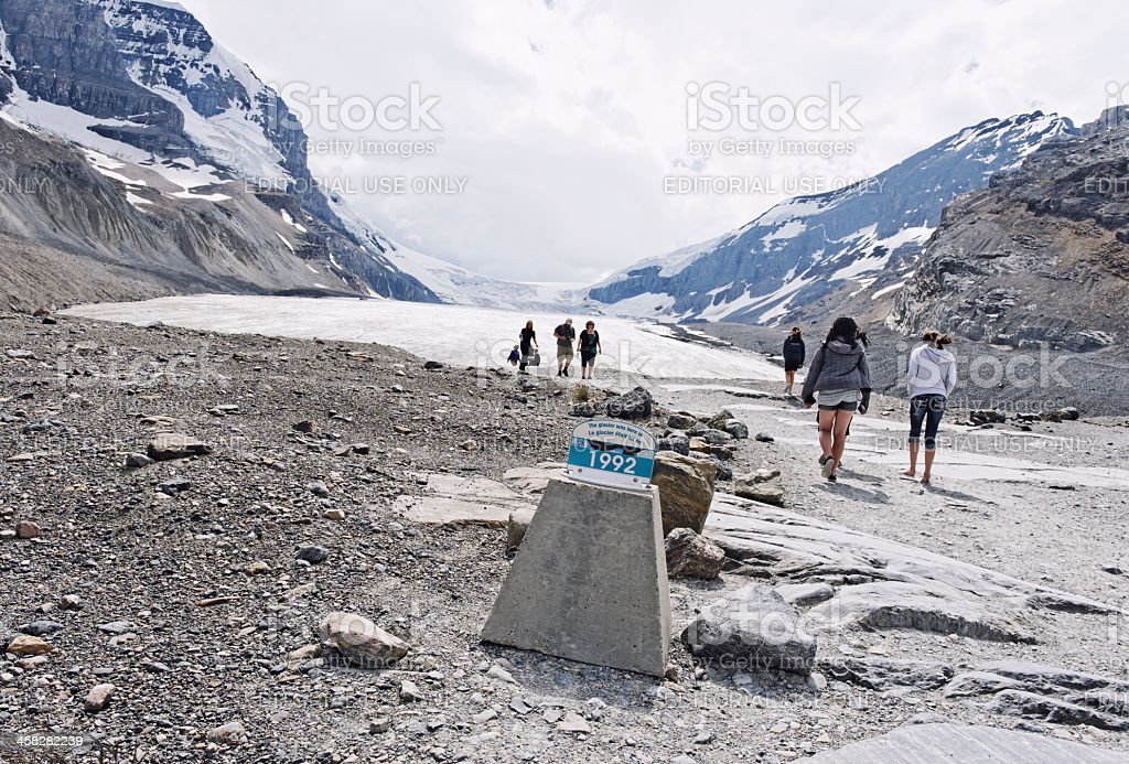 People hiking up to Athabasca Glacier, Jasper National Park,Canada royalty-free stock photo
