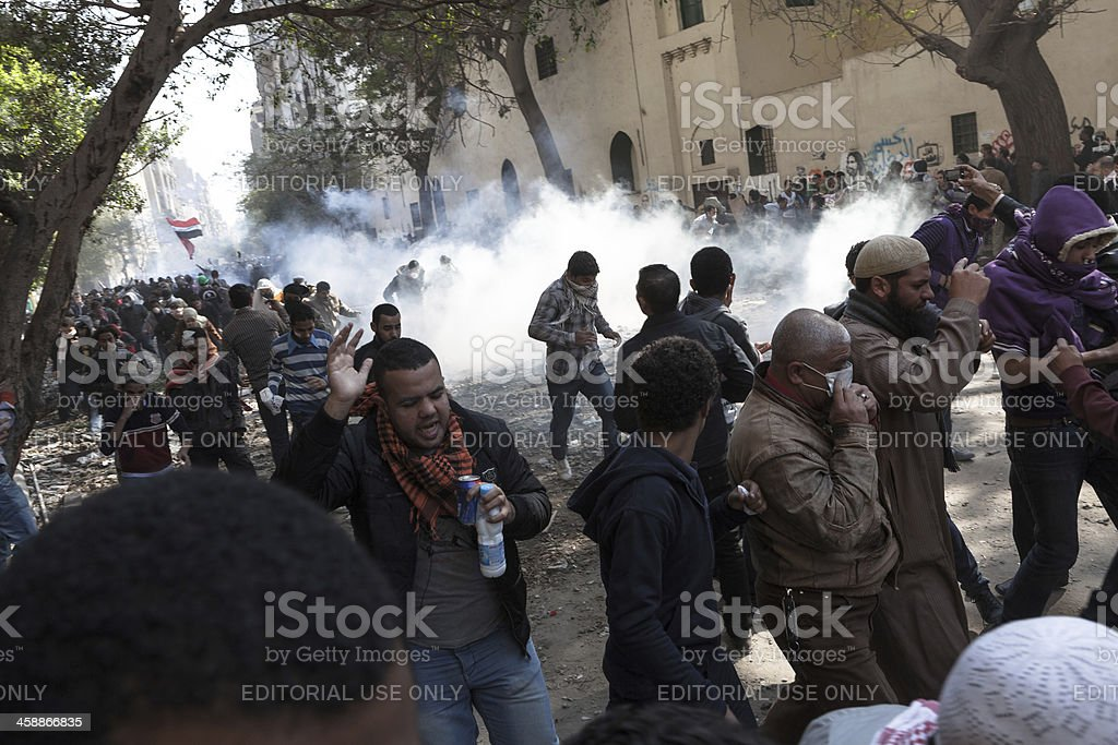 People hit by tear gas stock photo