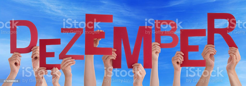 People Hold Word Dezember Means December Blue Sky stock photo