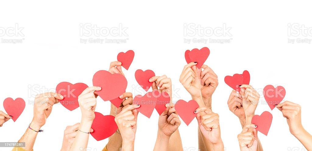 People holding an heart shape isolated on white stock photo