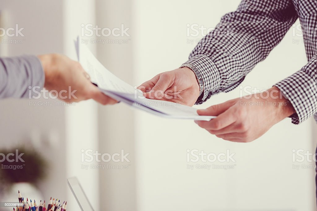 People holding documents, close up of hands stock photo