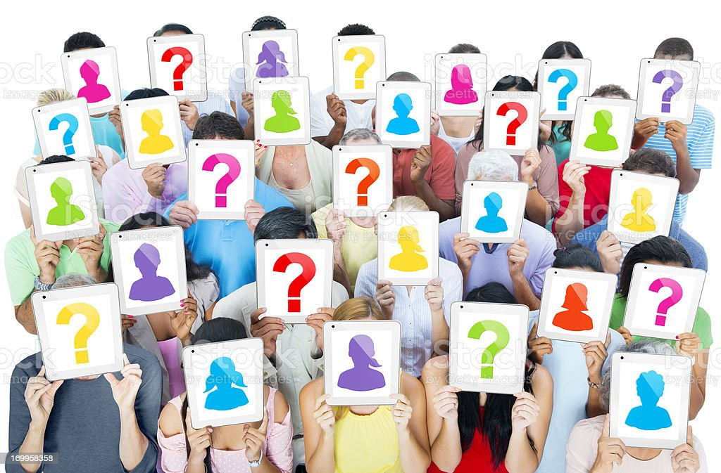 People holding frames with question marks hiding their faces stock photo