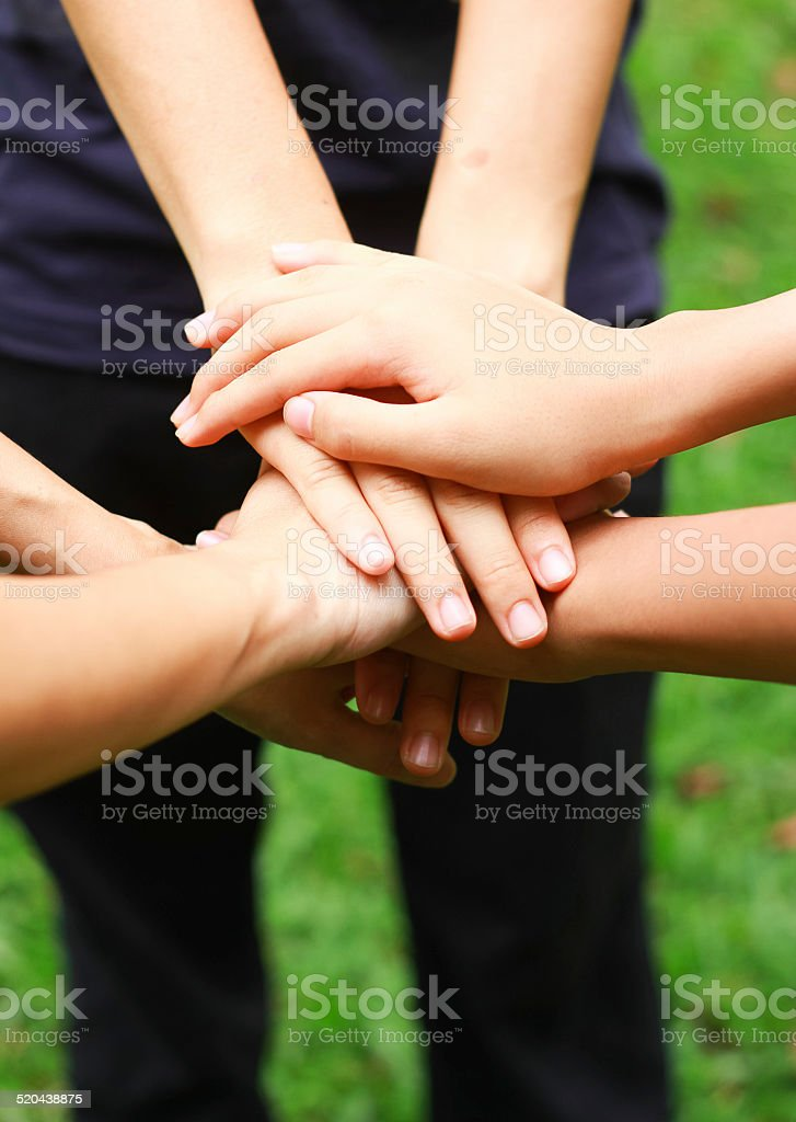 People holding hand together stock photo