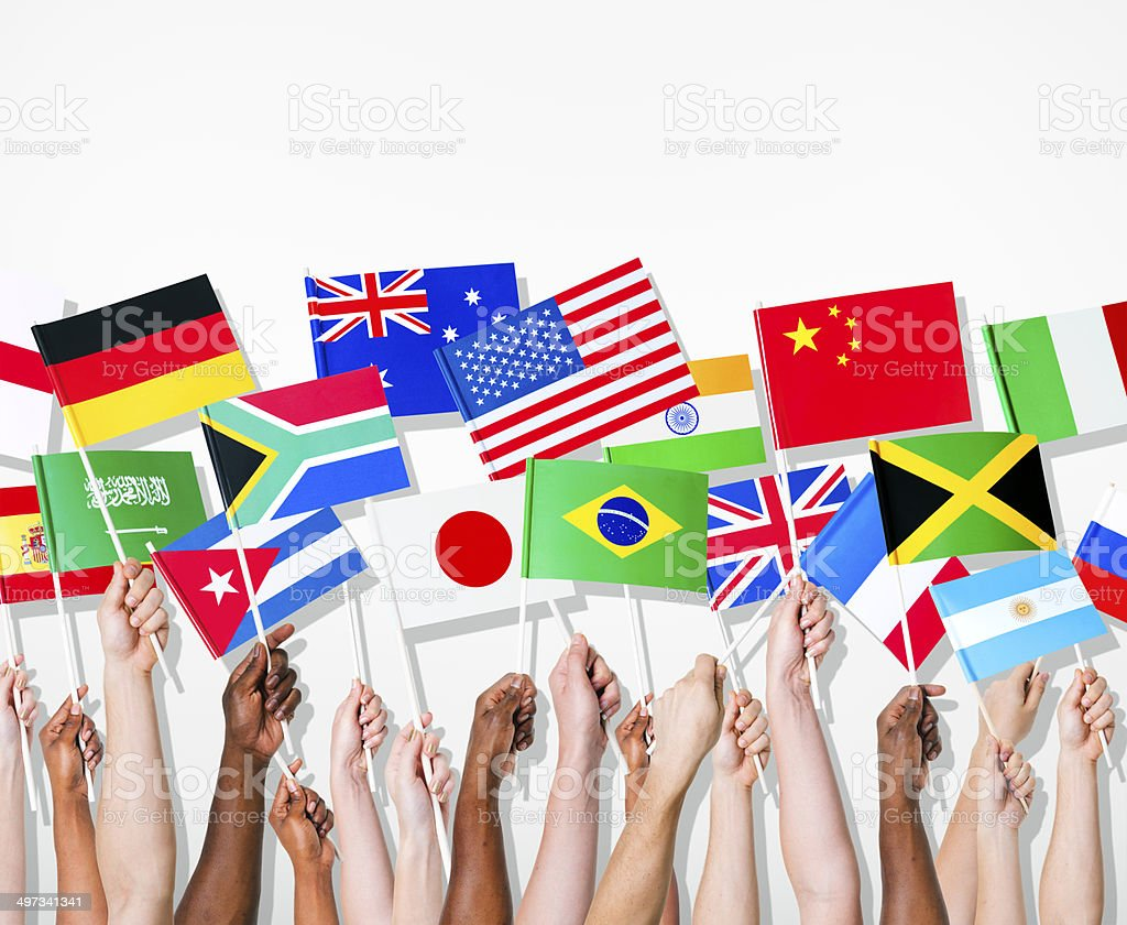 People Holding International Flags stock photo