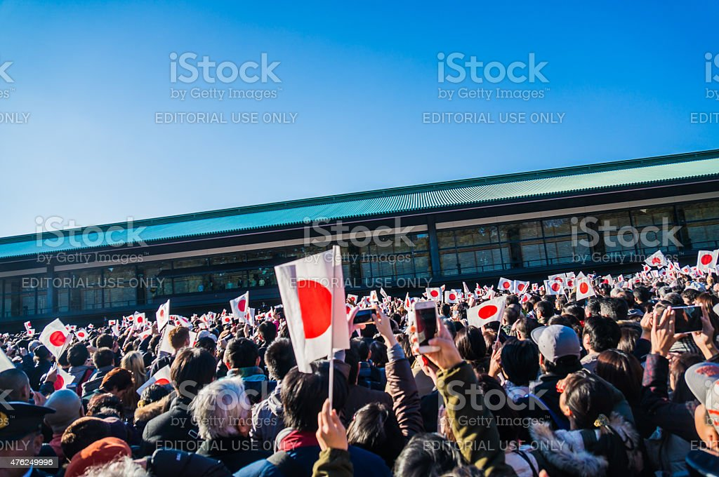 People holding Japanese flag in hand stock photo