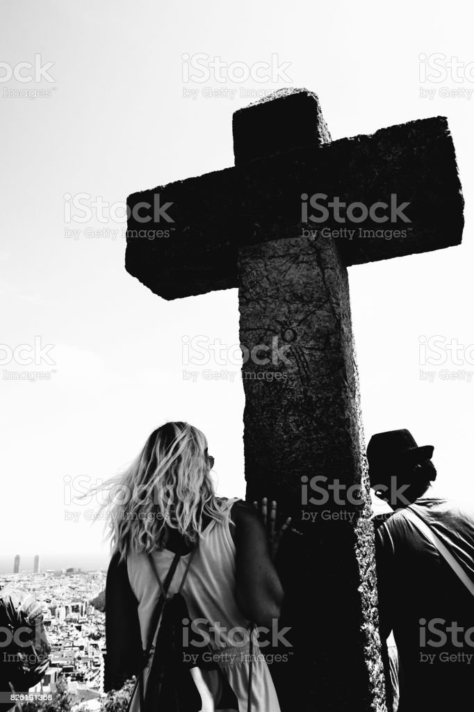 People holding on to a cross stock photo