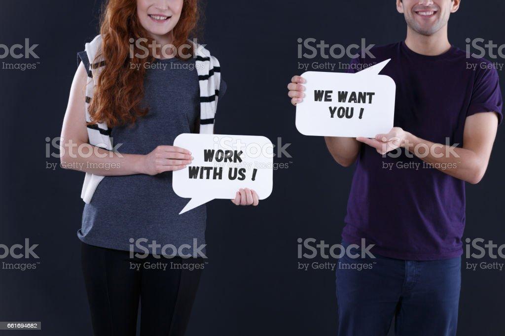 People holding speech bubbles stock photo