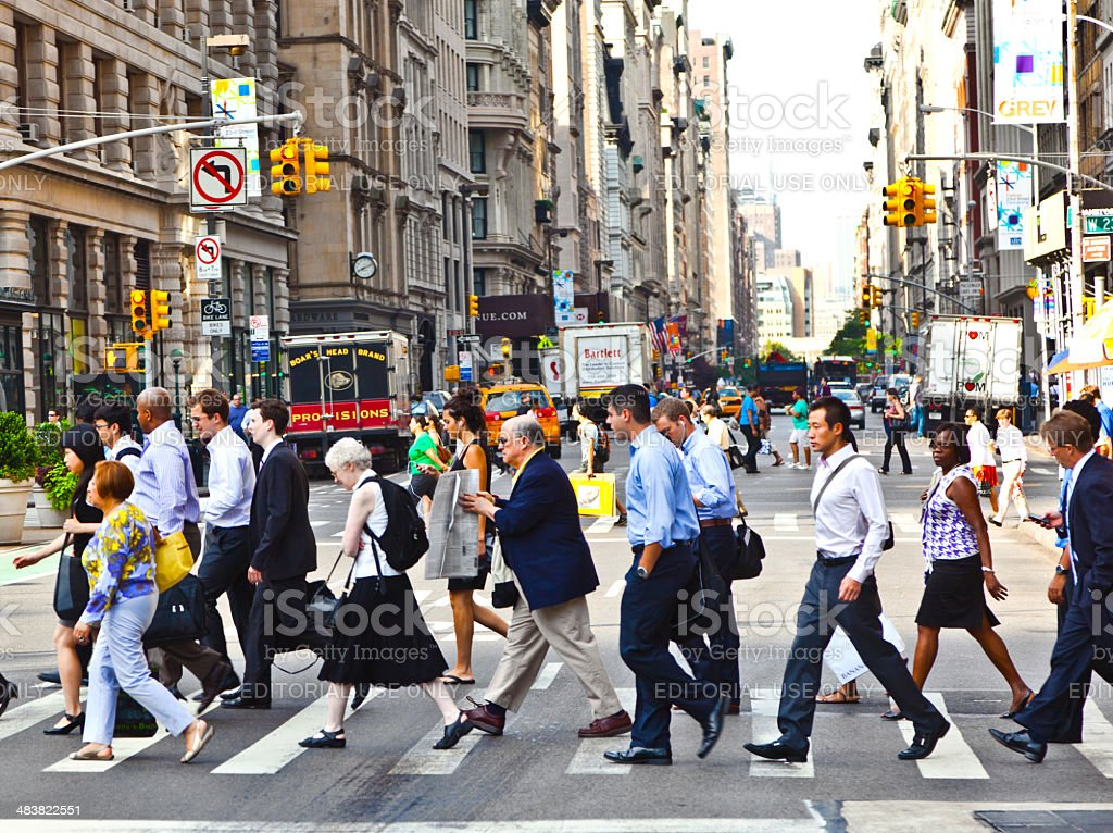 People hurry downtown Manhattan stock photo