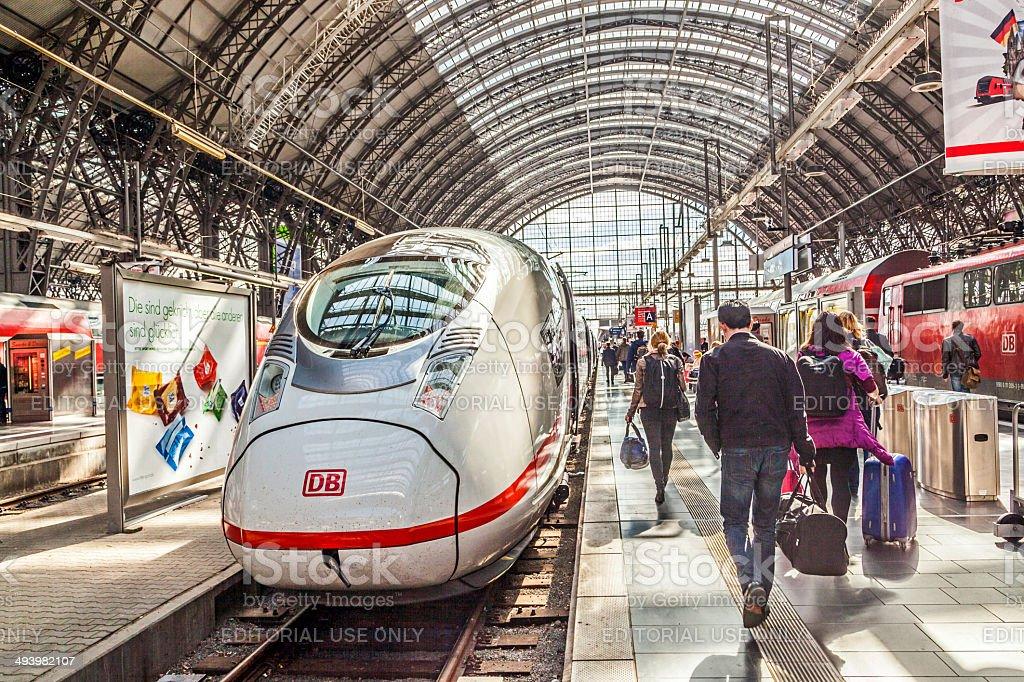 people hurry to train at Frankfurt railway station stock photo