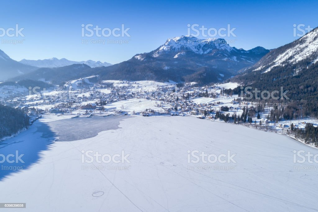 People Ice Skating on Frozen Lake Altausee, Winter Panorama, Austria stock photo