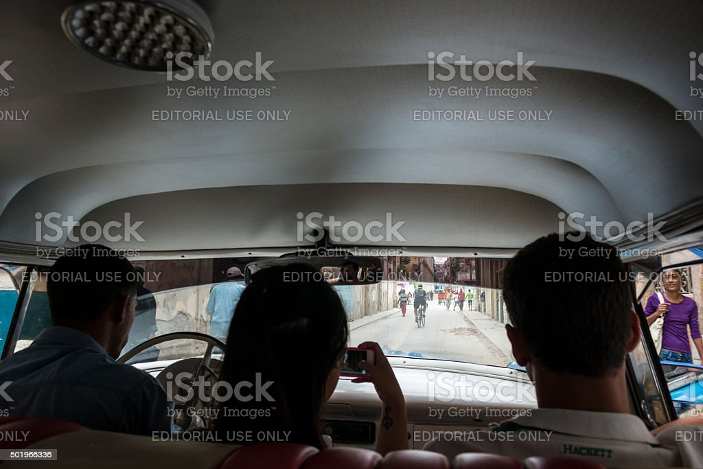 People in a 1956 Ford Fairlane in Havana Cuba stock photo