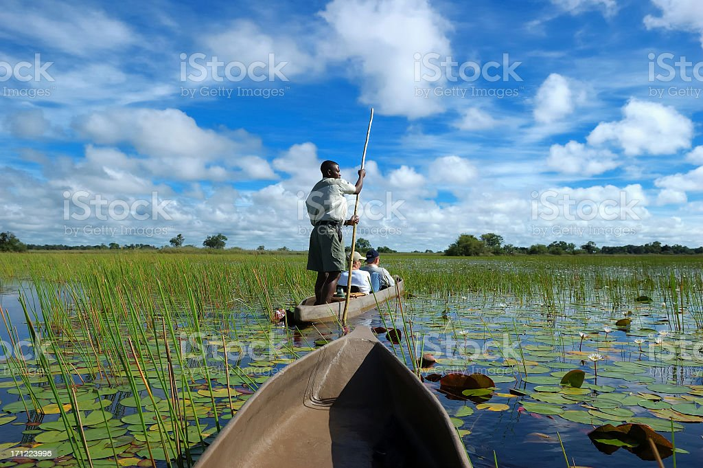 People in a boat in the Mokoro royalty-free stock photo