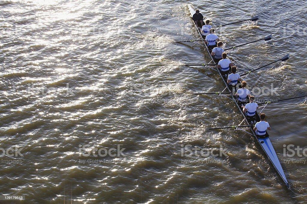 People in a canoe oaring stock photo