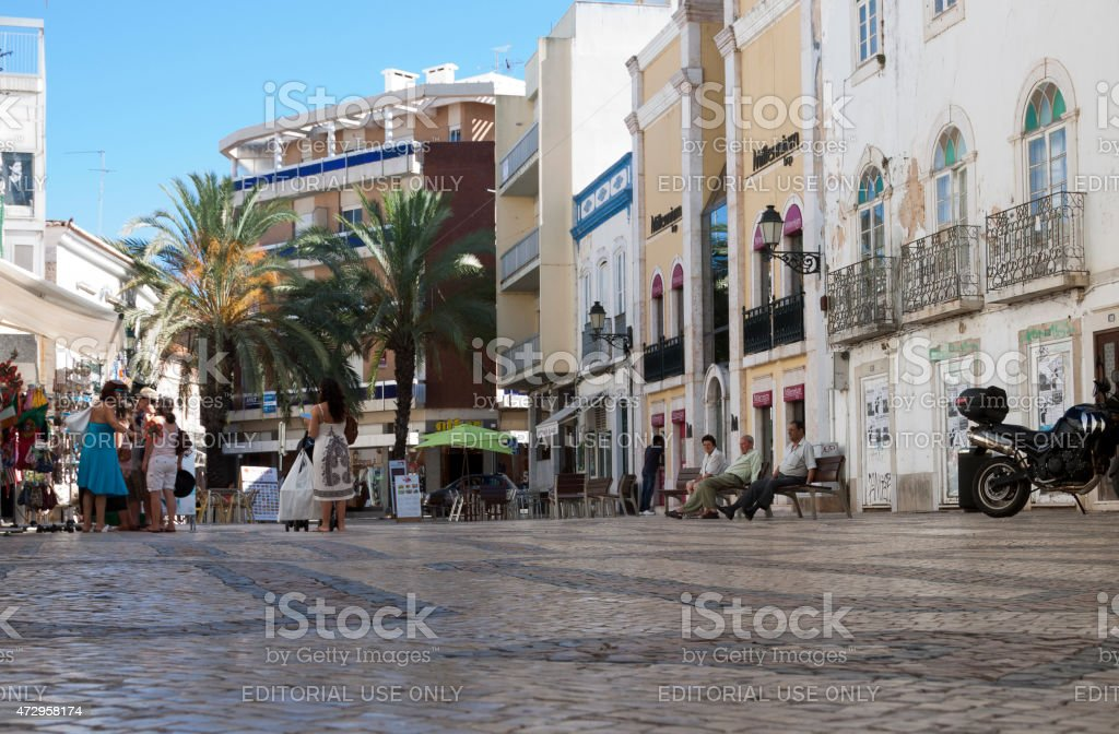 People in a shaded square in Faro Portugal stock photo