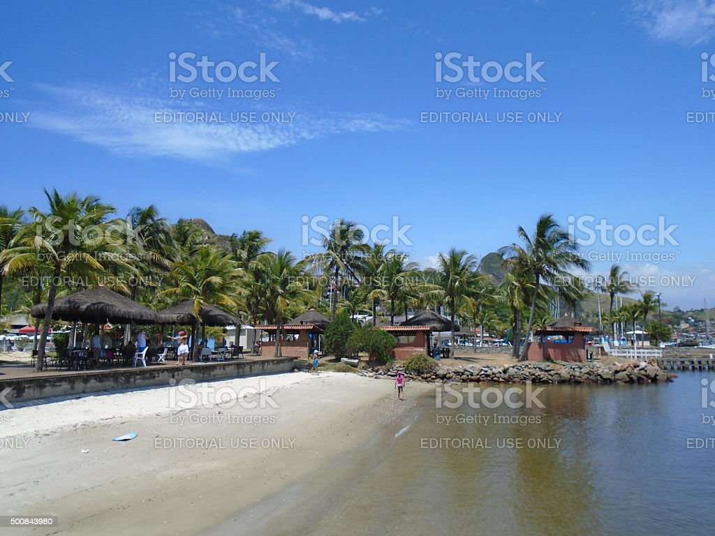 People in a small and calm beach in Brazil stock photo