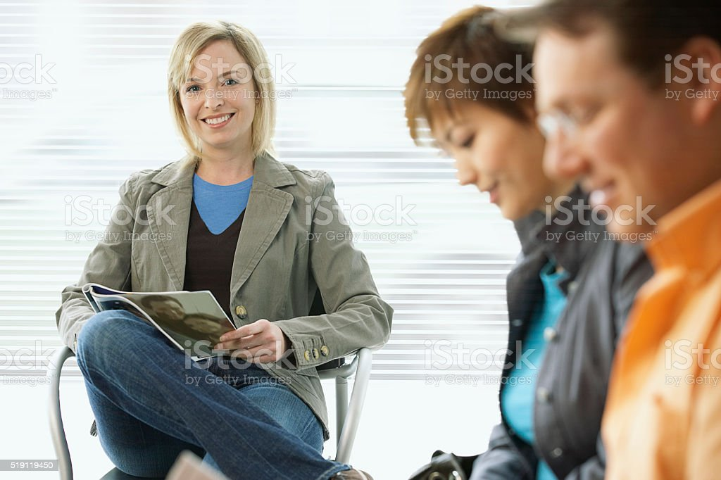 People in a waiting room stock photo