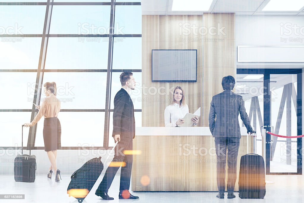 People in airport waiting for flight stock photo