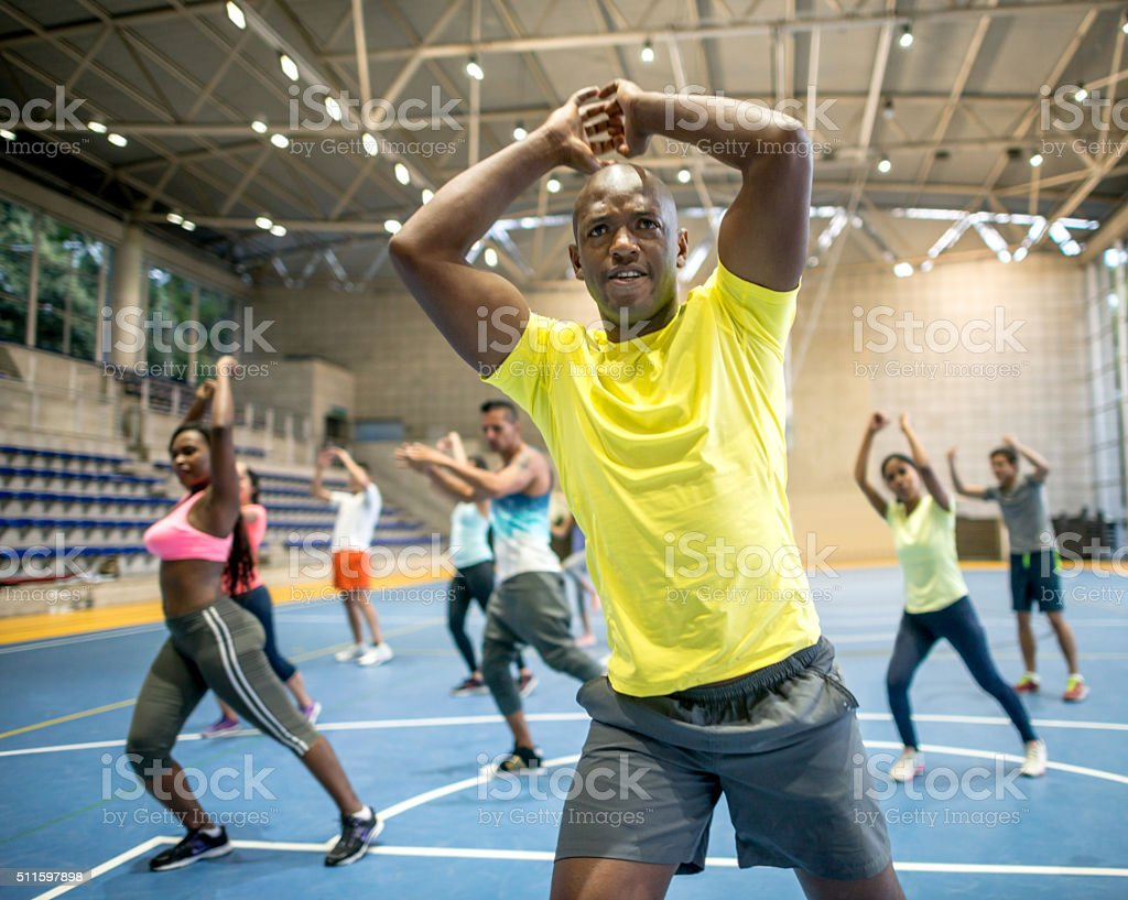 People in an aerobics class at the gym stock photo