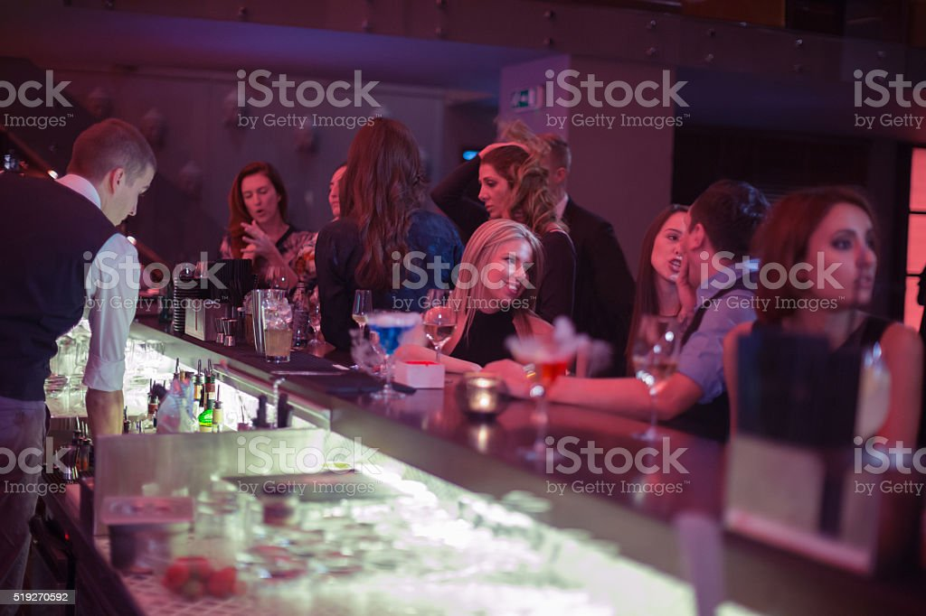 People in bar having drinks stock photo