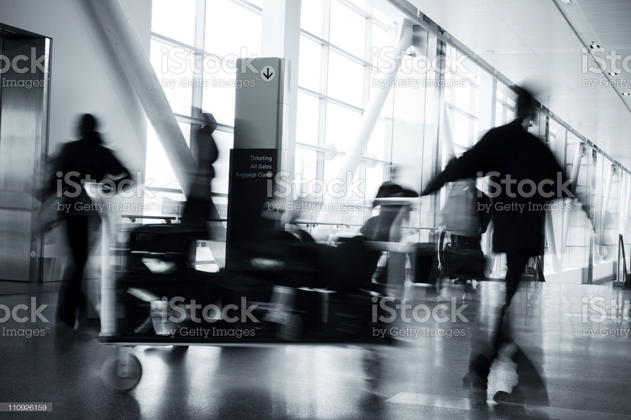 People in blurred motion at airport royalty-free stock photo