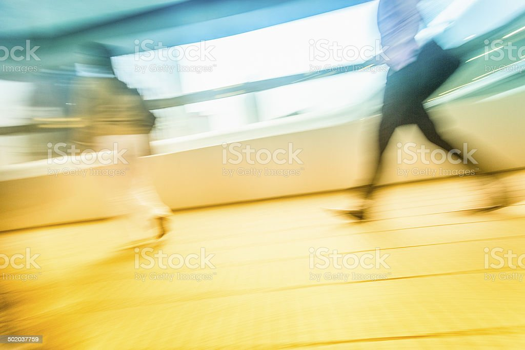 People in blurred motion at walkway royalty-free stock photo