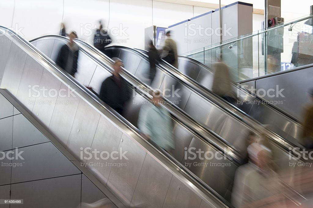 People in blurred motion on Escalator royalty-free stock photo