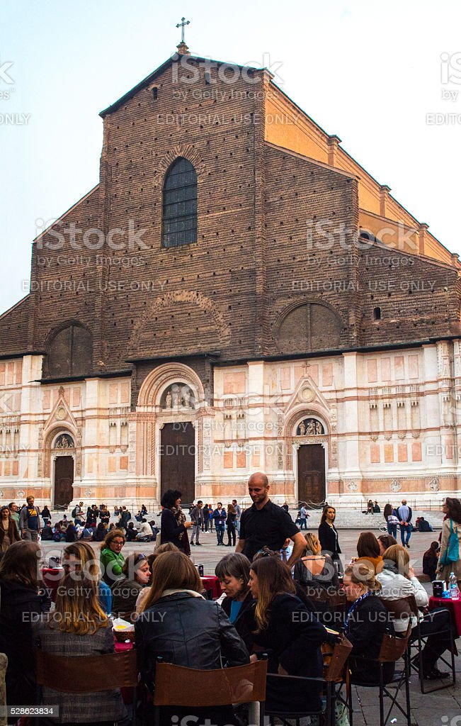 People in Bologna restaurant near Saint Petronio cathedral stock photo