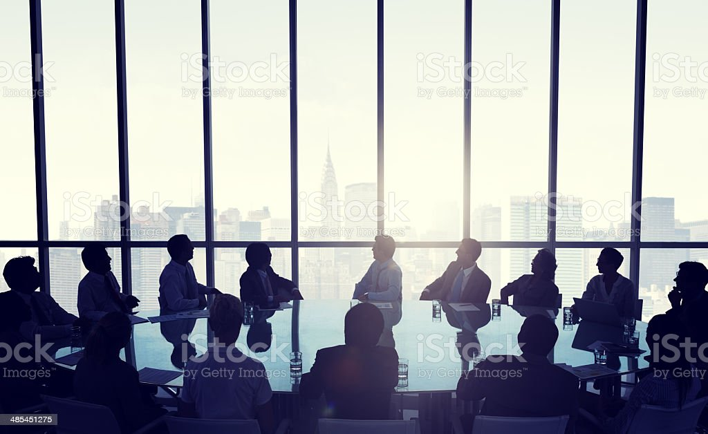 People in business meeting infront of New York city skyline stock photo