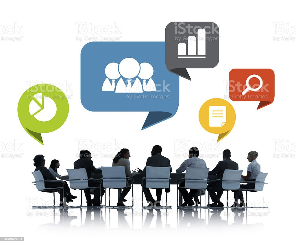 People in business meeting with office icons above stock photo