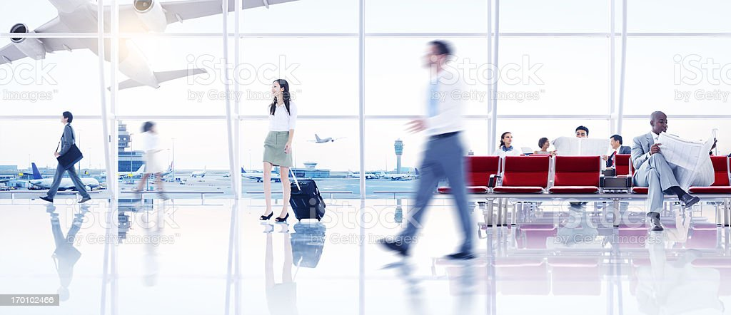 People in busy international airport terminal royalty-free stock photo