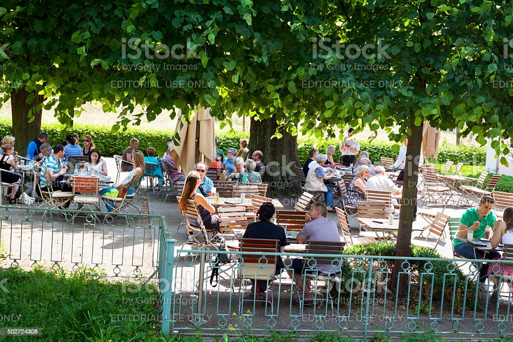 People in cafe garden at castle Benrath stock photo