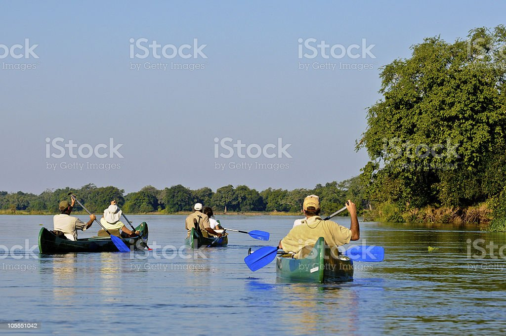 People in canoes on the Zambezi River stock photo