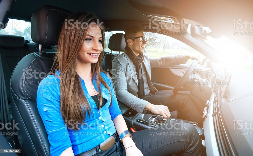 People in car driving and smiling stock photo
