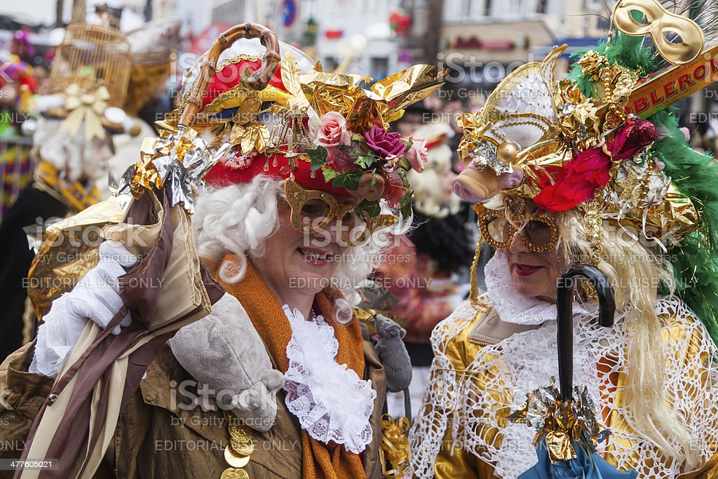 people in carnival costumes at the Rose Monday parade stock photo