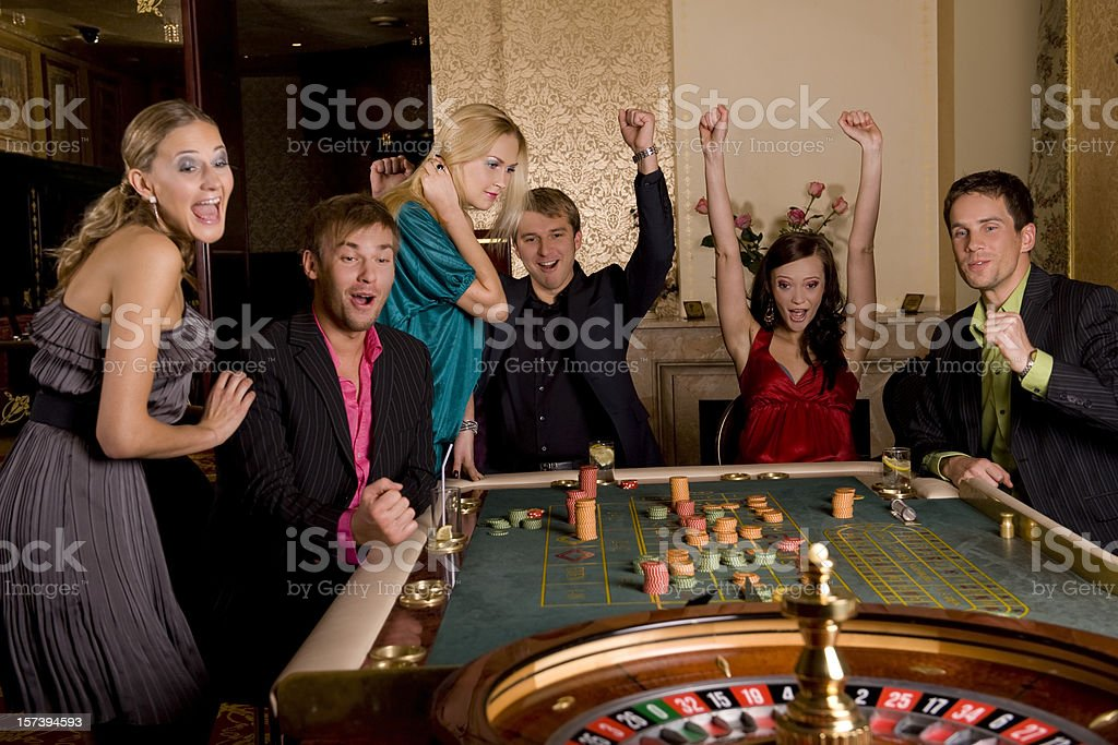 People in casino watching the wheel spin royalty-free stock photo
