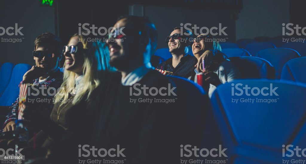 People in cinema smiling stock photo