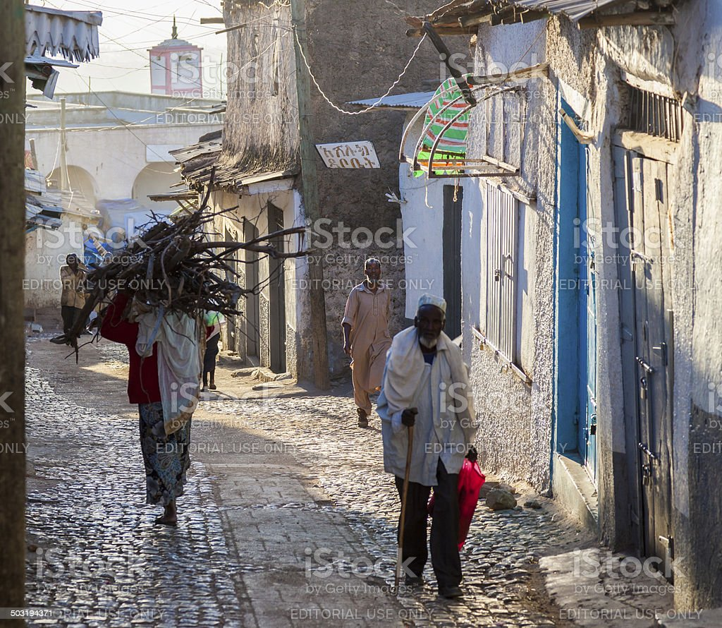 People in city of Jugol in their morning routine activities. stock photo