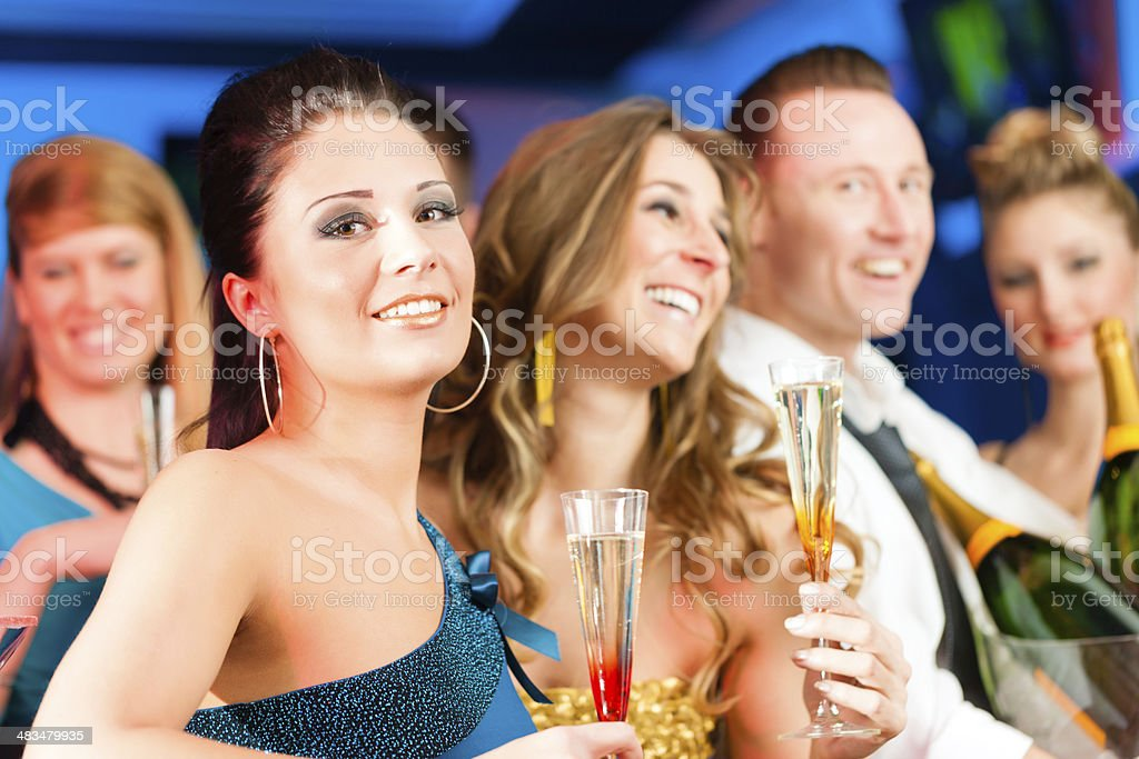 People in club or bar drinking champagne royalty-free stock photo