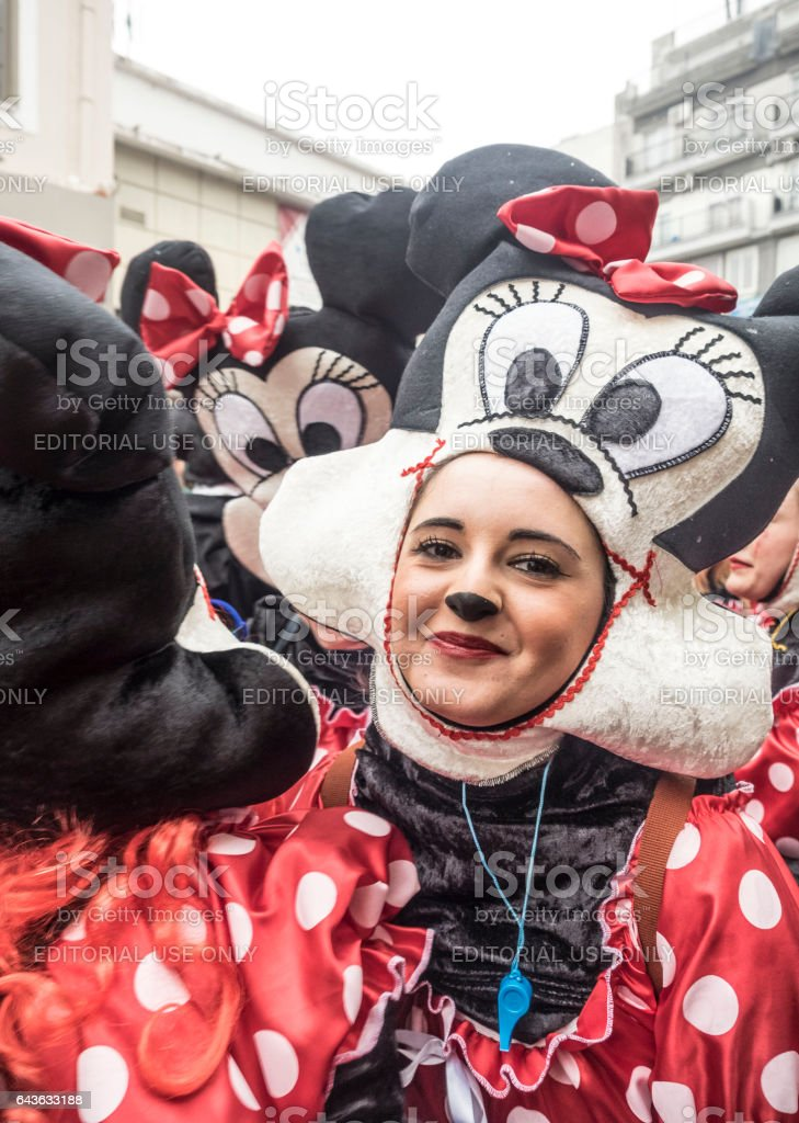 People in colorful costumes during the annual Carnival Parade in Xanthi, Greece. stock photo