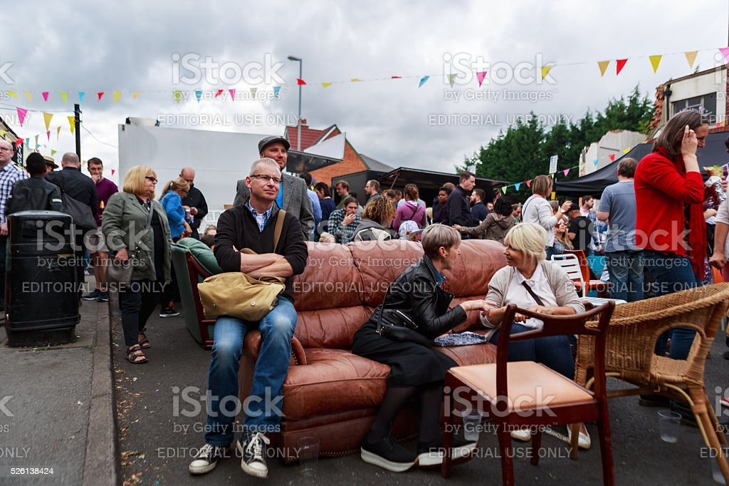 People in conversation in seating area at community event stock photo