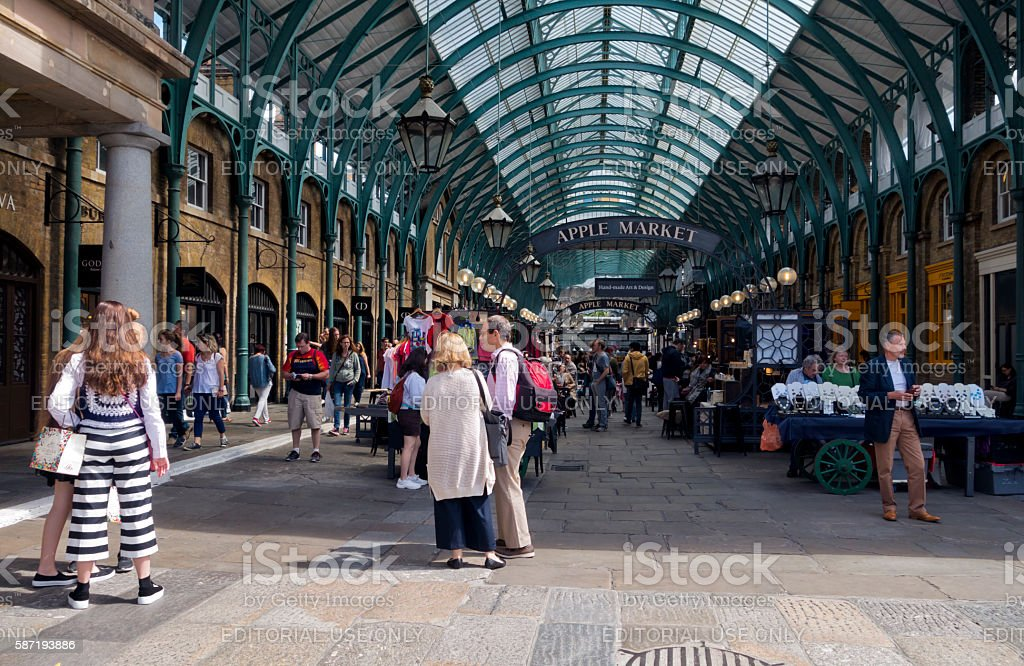 People in Covent Garden's old Apple Market stock photo