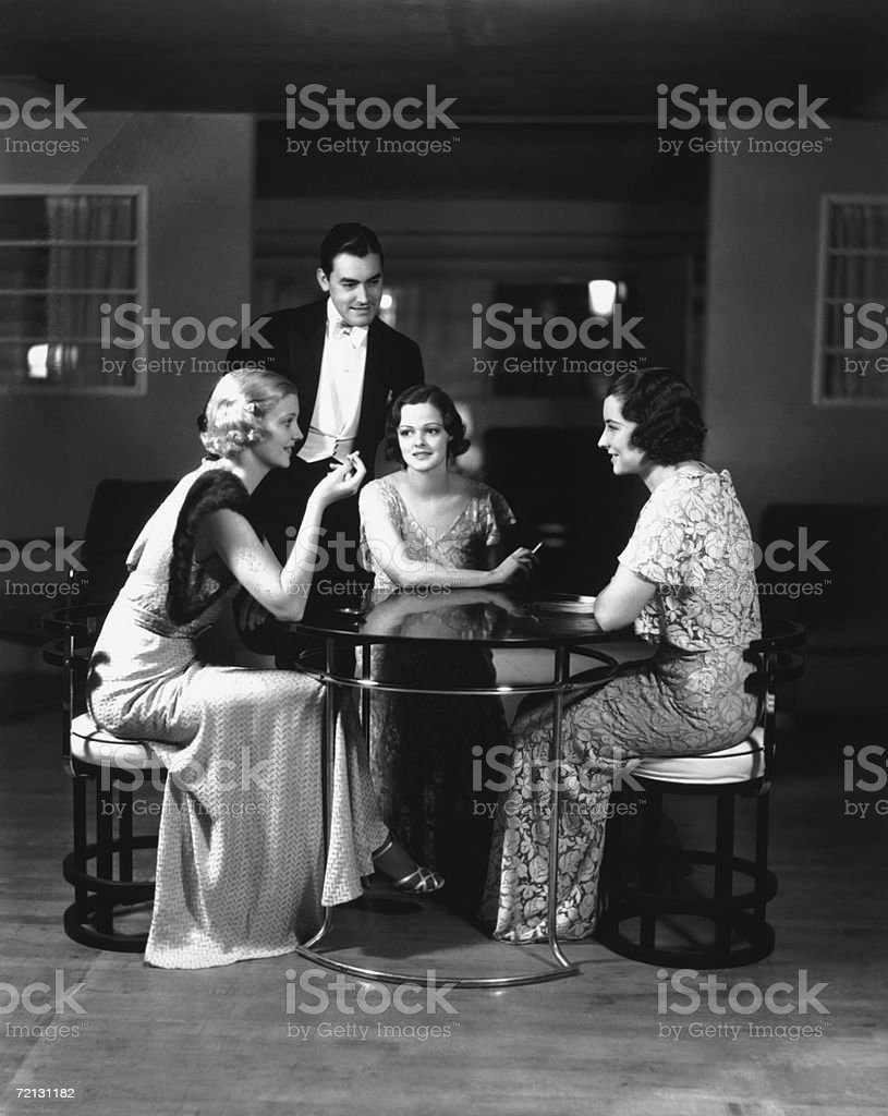 People in eveningwear at table (B&W) stock photo