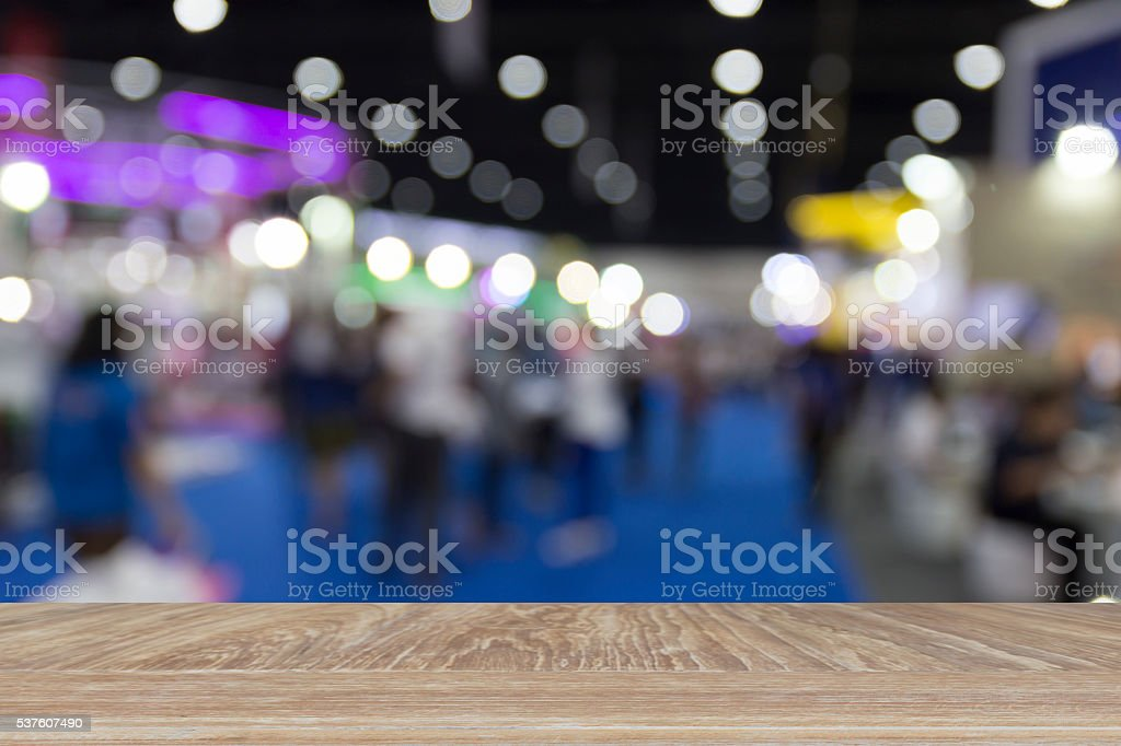 people in exhibition hall building, blur background stock photo