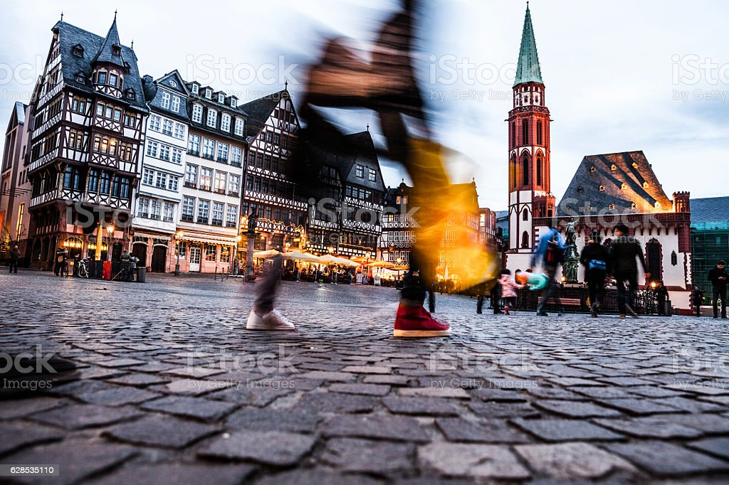People in Frankfurt old town square at dusk stock photo