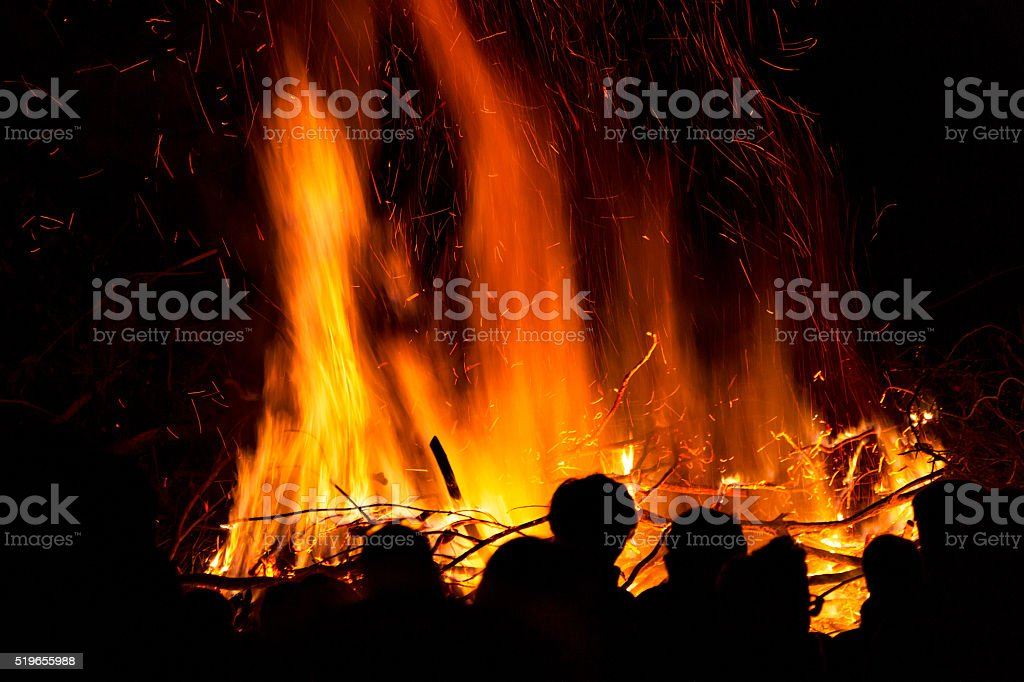 People in front of a fire stock photo