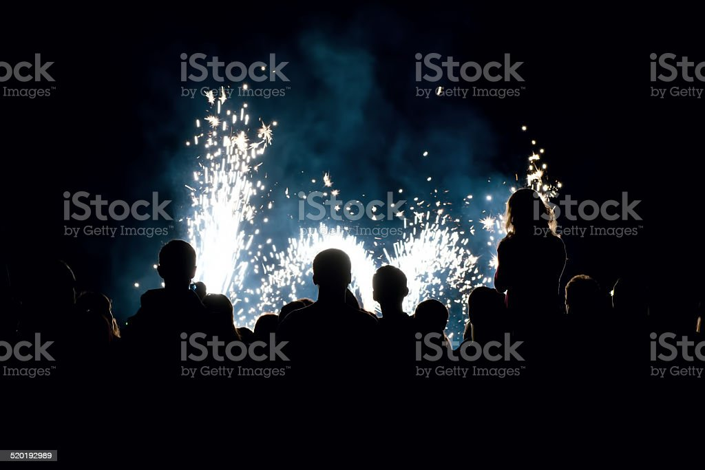 people in front of a fireworks stock photo