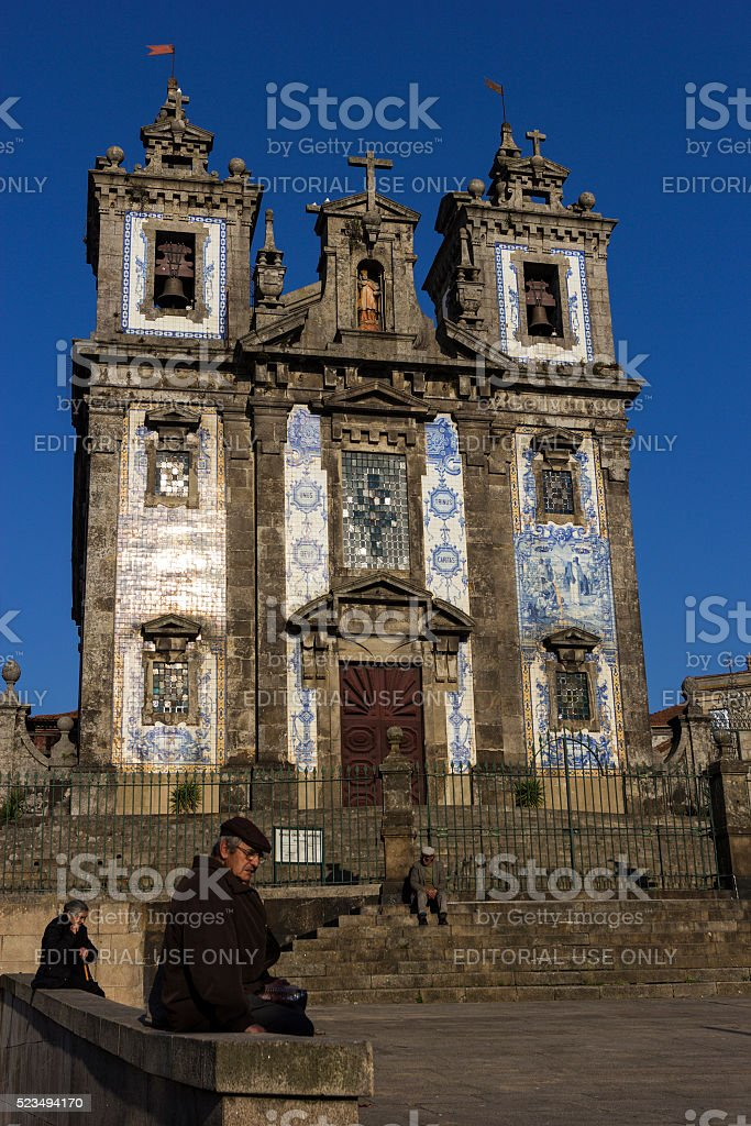 People in front of Church of Saint Ildefonso in Porto stock photo