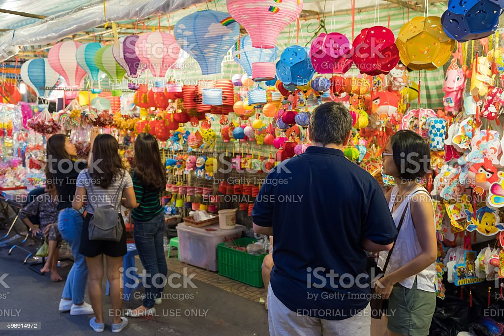 People in front of lanterns and toys stand stock photo
